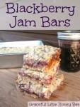 Blackberry Jam Bars on wooden cutting board.