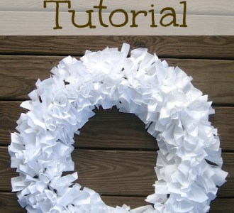 White rag wreath on a wooden background.