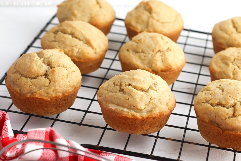 Applesauce muffins sitting on a wire cooling rack.