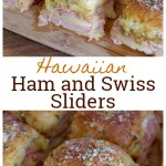 Ham and cheese sliders sitting on a wooden cutting board.
