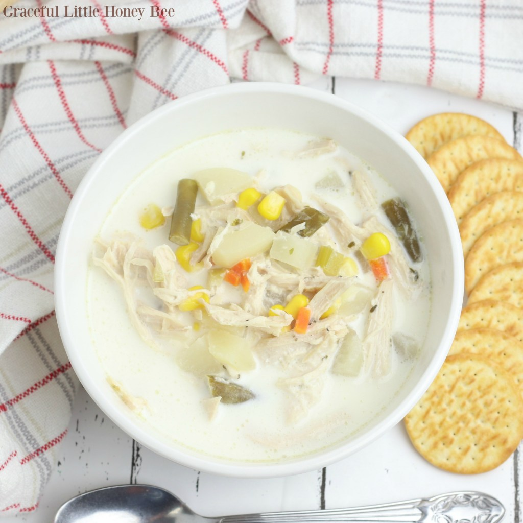 This Slow Cooker Chicken Pot Pie Soup has all of the comforting flavors of the traditional dish that you love without work! Find the recipe at gracefullittlehoneybee.com
