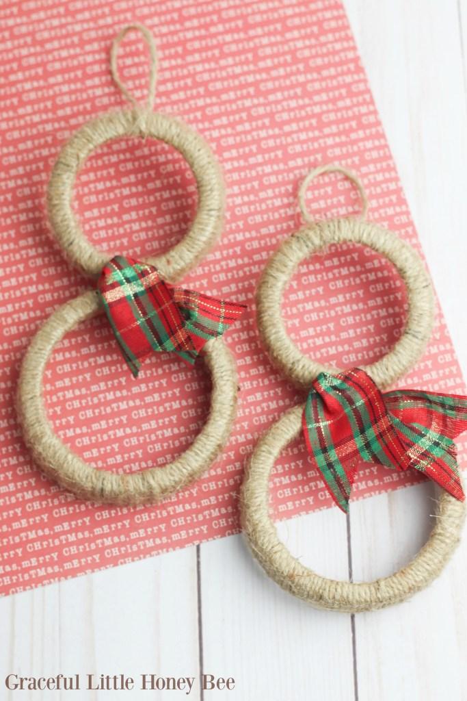 All you need is twine, mason jar lids, ribbon and hot glue to make this simple Mason Jar Lid Snowman Ornament!