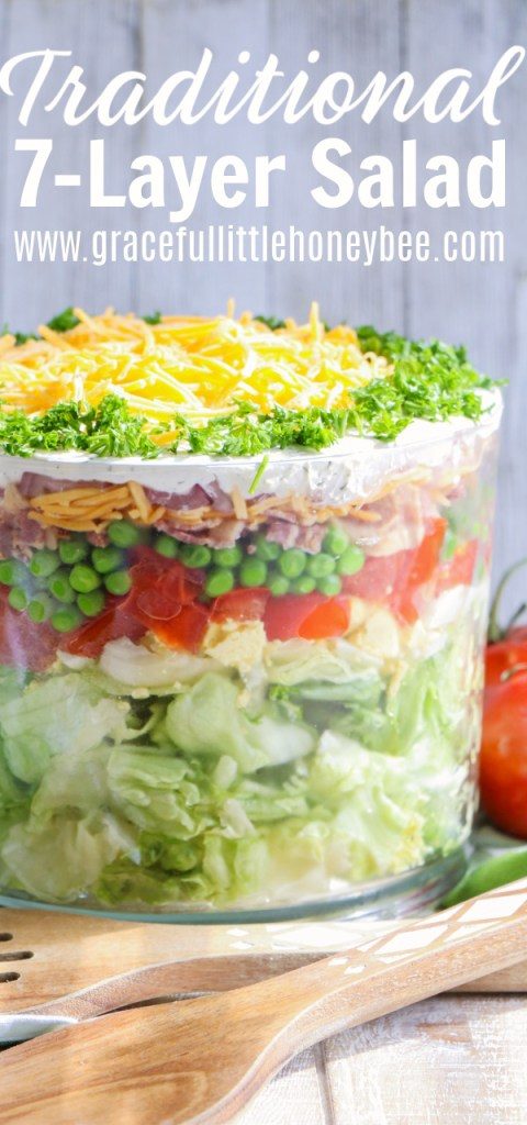 7-Layer Salad in glass trifle bowl.