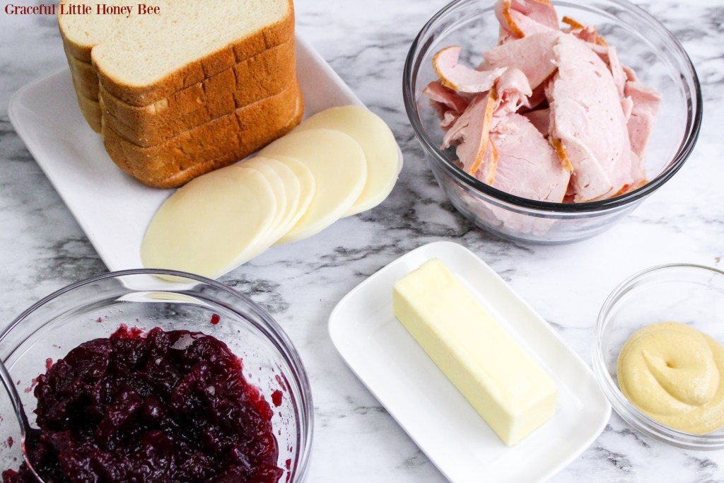 All of the ingredients for Turkey Cranberry Grilled Cheese sitting on a marble countertop.