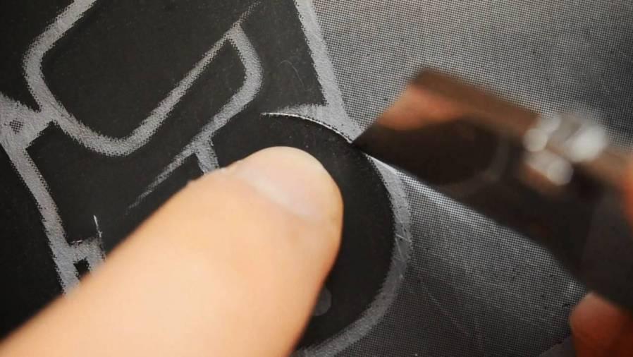 Pahnl cutting a stencil