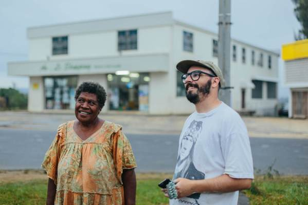 The-Wanderers-episode-Street-Artist -RONE_RONE sharing his finished portrait with MILDRED KALSAKAU, the subject, in the heart of Port Vila, Vanuatu_credit Callie Marshall_I5A3179