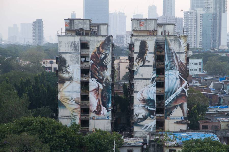 Guido Van Helten, Mahim (E) Art District, St+art Urban Art Festival, Mumbai 2017. Photo Credit Akash Shukla