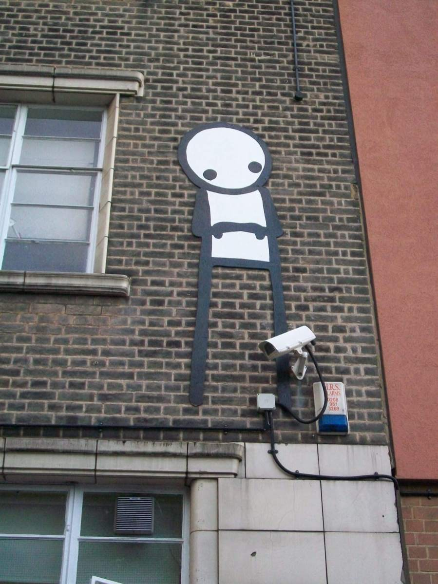 "Stik, Wooden Stik Sculpture ""Up on the Roof"" to be auctioned off at Christies Auction House for Cardboard Citizens Charity 2018. Photo Credit Stik"