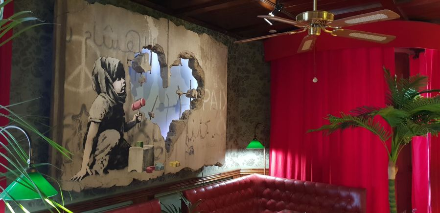 Banksy artwork, The Walled Off Hotel, West Bank, Bethlehem, Palestine 2019.