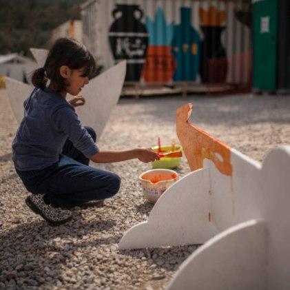 Ruben Sanchez's Latest Mural Revives the Lost Art of Caring, Moria Camp Lesbos 2019. Photo Credit Samantha Robison aptART