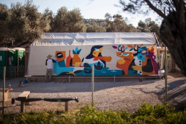 Ruben Sanchez's Latest Mural Revives the Lost Art of Caring, Moria Camp Lesbos 2019. Photo Credit Samantha Robison aptART