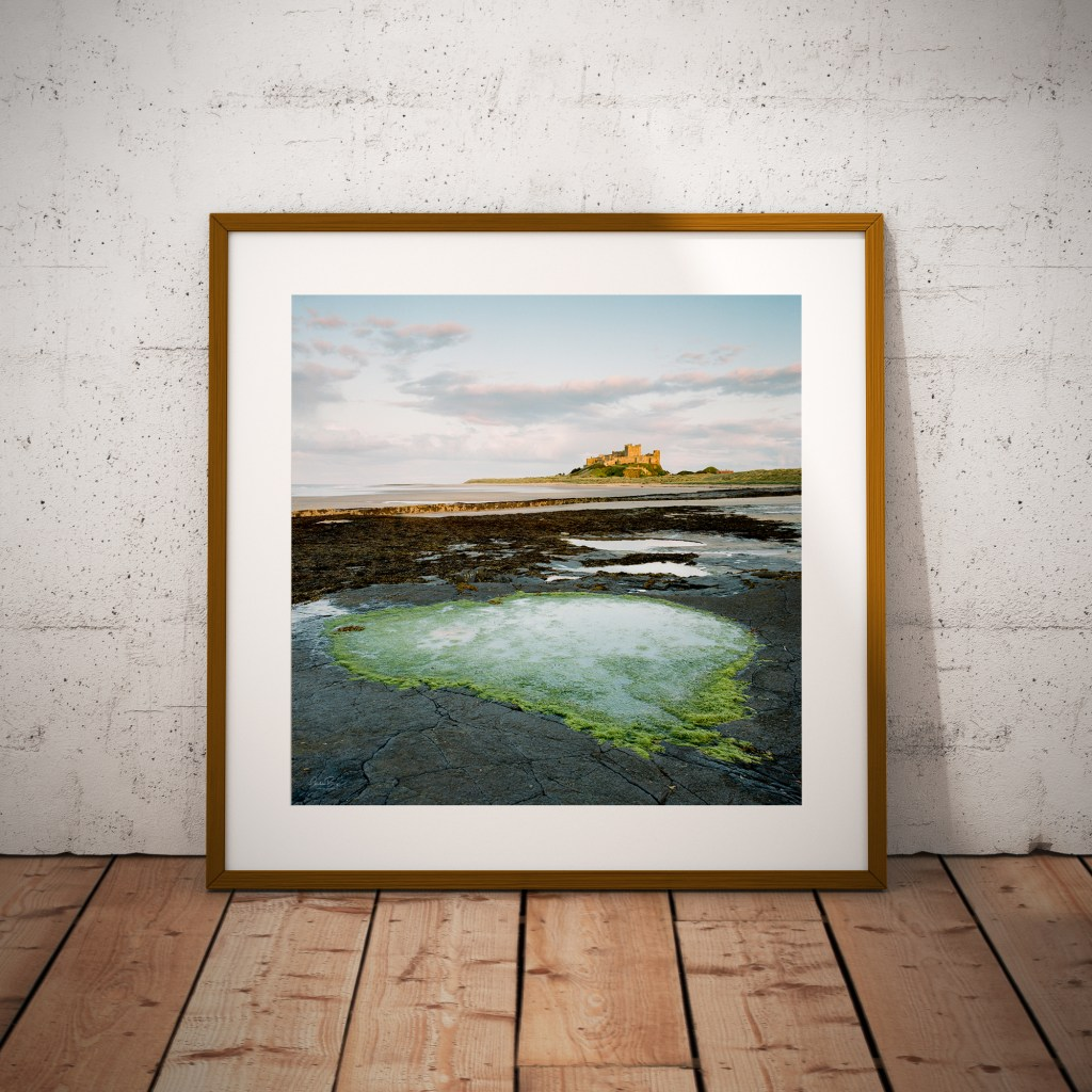 Bamburgh Castle Heart Rock Pool Framed Print