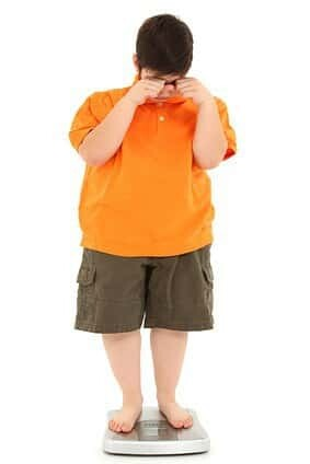 Morbidly Obese Fat Child on Scale