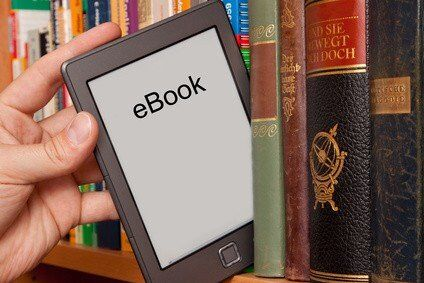 ebook reader on bookshelf