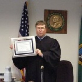 Justice Korsmo accepts his certificate of appreciation