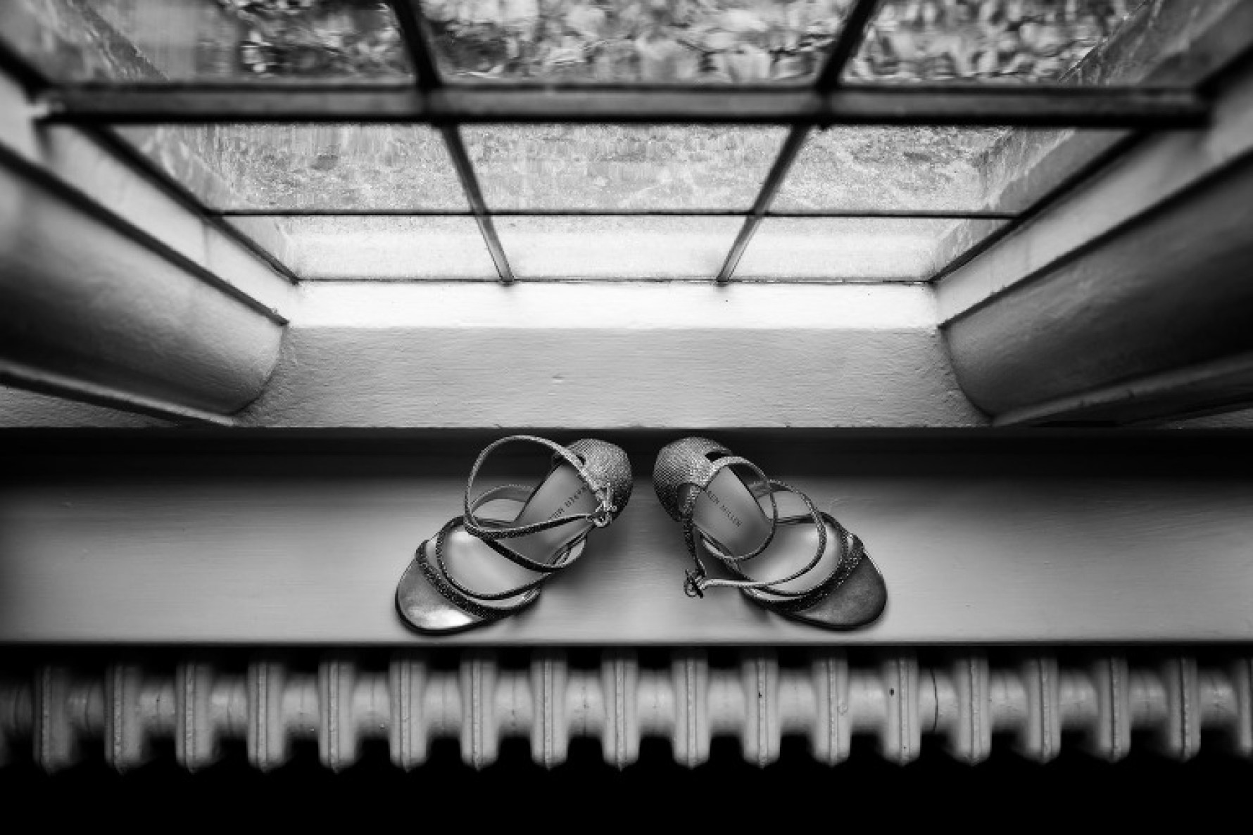 Bride's shoes at her Hertfordshire wedding at Hanbury Manor