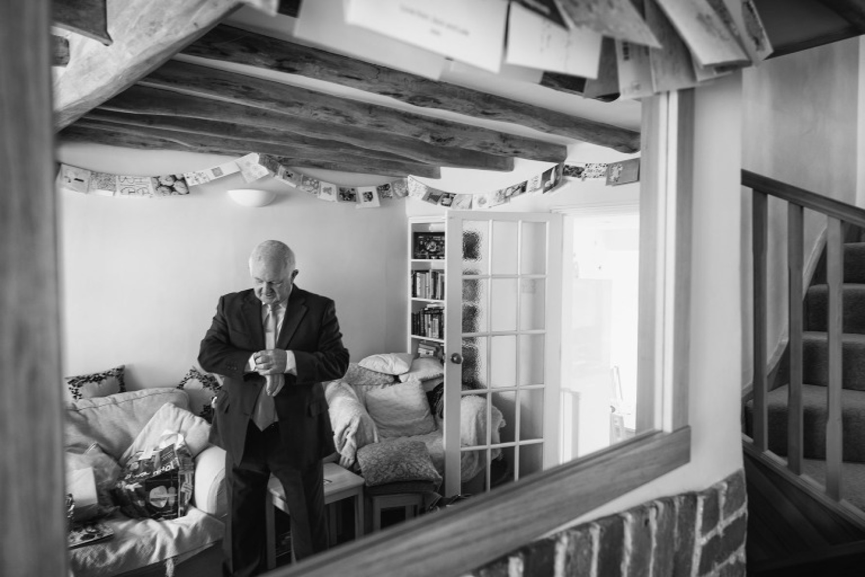 Dad checks his watch during Becky's bridal preparations by Hertfordshire wedding photographer