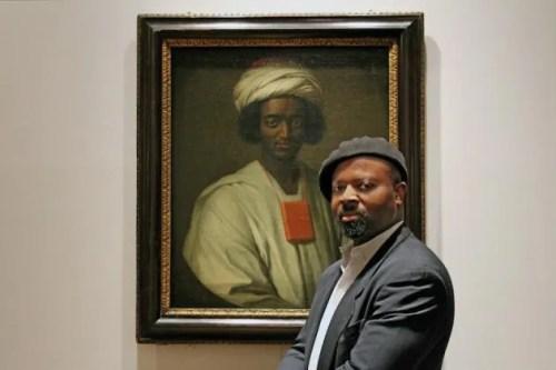 Ben Okri with the portrait of Ayuba Suleiman Diallo by William Hoare