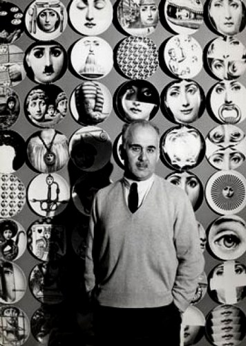 Piero Fornasetti with some of his plates