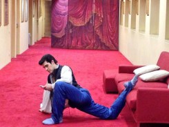 Roberto Bolle stretching outside the press offices