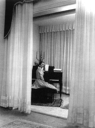 Maria Callas at home in Milan with the candelabra given to her by La Scala, 1955