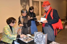 Barbara Luisi signs calalogues at the Roonee 247 Fine Arts Gallery in Japan