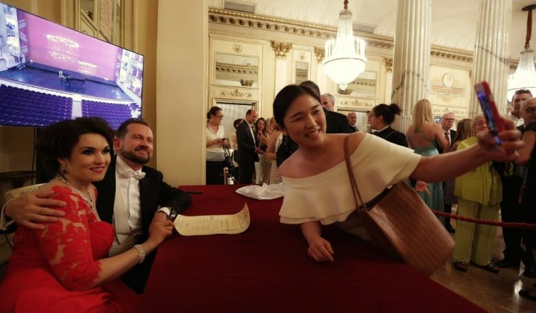 Olga Peretyatko with her pianist Giulio Zappa during an autograph session after her recital