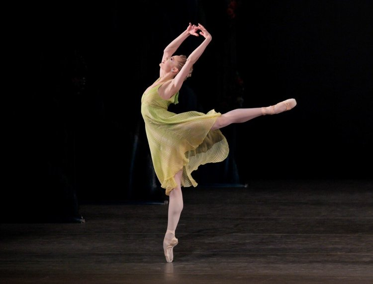 """Sara Mearns of New York City Ballet in """"Spring"""" from Jerome Robbins' The Four Seasons, photo by Paul Kolnik"""