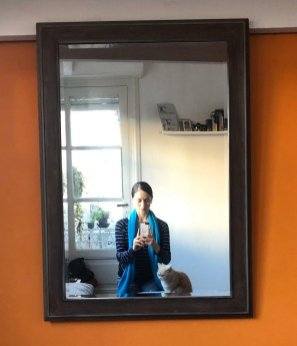 Self portrait with orange wall and cat