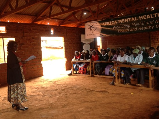 Dr. Victoria Mutiso leads a community psycho-education session in a school.