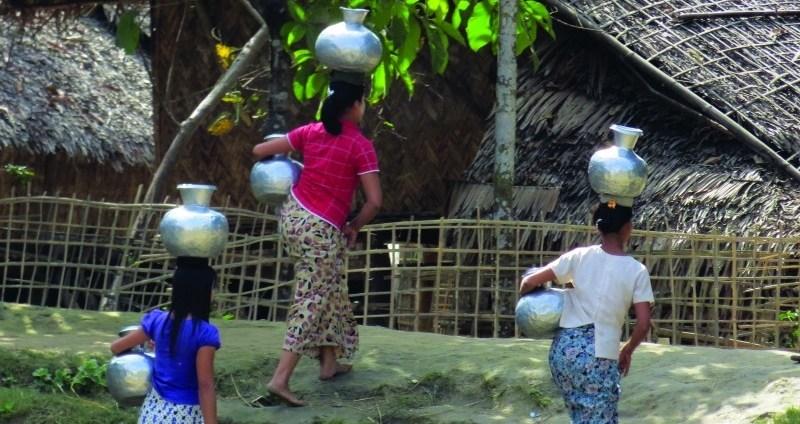 Women carrying water in Myanmar