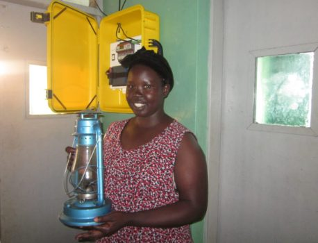 Before the Solar Suitcase, Claire, a midwife, had to rely on a kerosene lamp to provide light in the health facility where she works. Photo courtesy of We Care Solar®