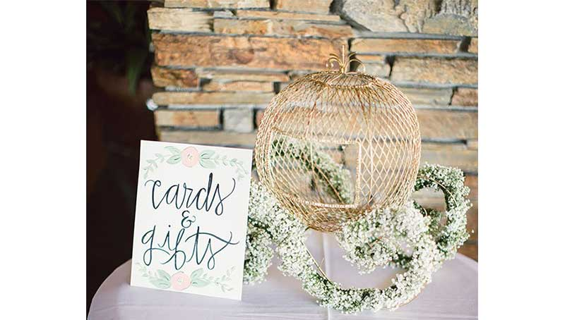 cards and gifts table sign with charriot