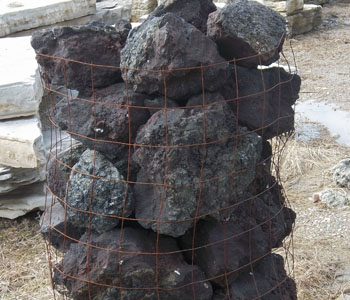 black lava boulders grand river