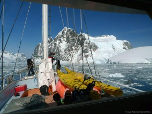 Jim Surette films on the deck of the Australian sailboat The Australis, Lemaire Channel, Antartica, 2009. Photo: Doug Workman