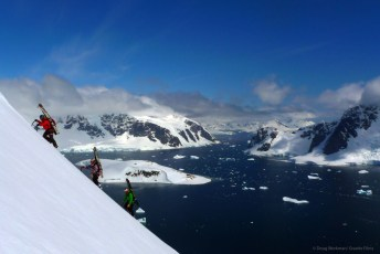 Stian Hagen, Andrea Binning, and Chris Davenport on the summit ridge of The Sphinx, Antarctic Peninsula. Photo: Doug Workman