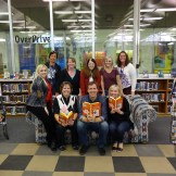 Jeff Kinney poses with Granite school librarians and staff who volunteered at the event.