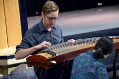 Photo of teacher playing instrument for Spring Lane students