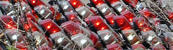 Police lights arrayed for sale or storage in the lot of the NYPD auction yard.