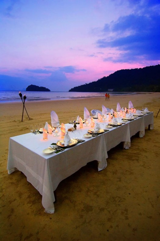 An inviting wedding dinner set up on the beach at the Datai Langkawi