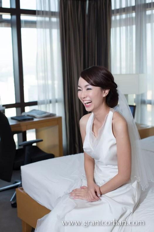 Happy Chinese Bride waits for her husband at Berjaya Times Square