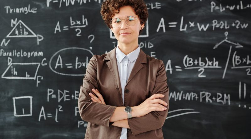 teacher standing in front of blackboard