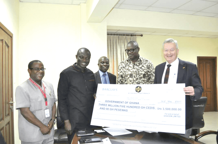 Mr Morten Gade (right) supported by Dr George Dawson-Ahmoah (2nd right) handing over a dummy cheque to Mr Kwaku Kwarteng (2nd left), while Mr Tony Dadzra and Mr David Quist of the Ministry look on