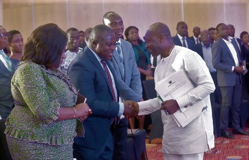 Mr Ken Ofori-Atta, the Finance Minister, exchanging pleasantries with guests after the KPMG 2020 Budget Forum in Accra. Picture by SAMUEL TEI ADANO