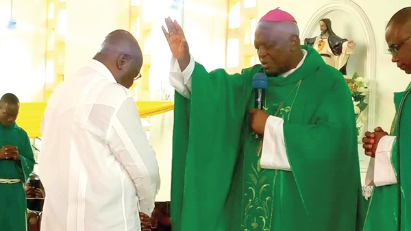Rt Rev. Joseph Afrifa Agyekum (right), the Catholic Bishop of the Koforidua Diocese, saying a prayer for President Akufo-Addo