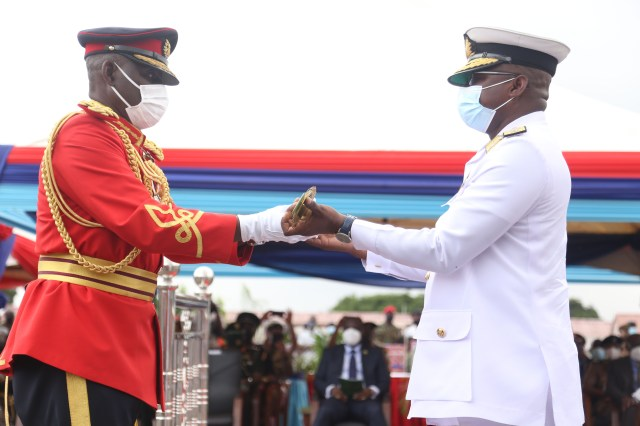 Lt. Gen. Obed Boamah Akwa (left), the outgoing Chief of Defence Staff (CDS), handing over the staff of authority to Rear Admiral Seth Amoama, the Acting CDS