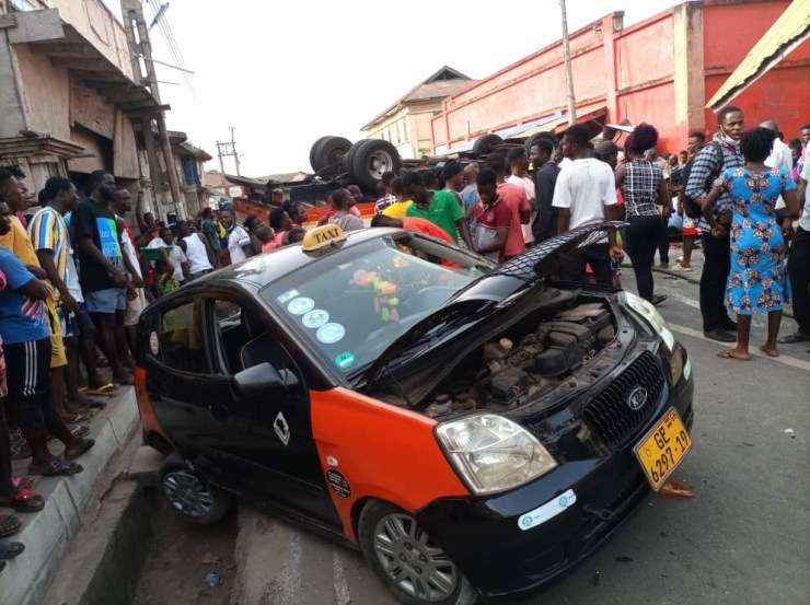 Two injured after truck rams into six cars, shop 9