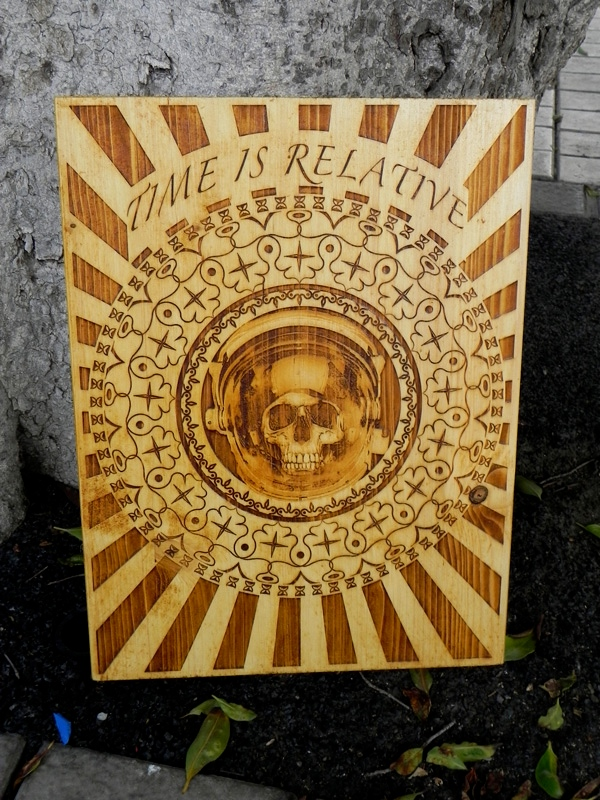 """""""Time is Relative """" by Diego Scaglia Rat, laser engraved on pine wood, 11,8"""" x 15,7 """""""