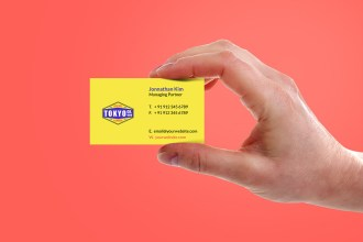 Hand Holding Business Card Mockup PSD