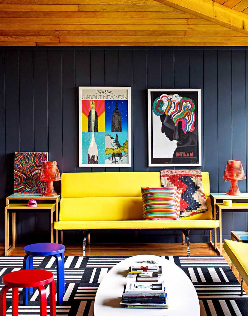 Pop art theme room with art painting wall, red blue chairs also stripes accent pillow